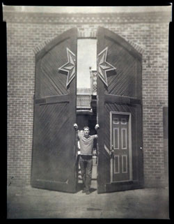 Shane C. Welch Standing near the Sixpoint Door