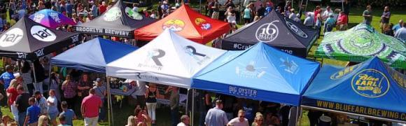 crowds gather around their favorite brewery tents