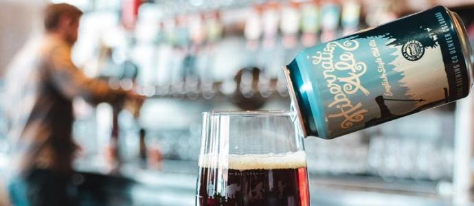 pouring Hibernation Ale into glass